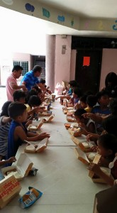 Brother Leo and Bro Dodong feeding the children.